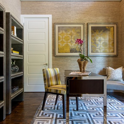Example of a mid-sized transitional freestanding desk dark wood floor study room design in Dallas with brown walls