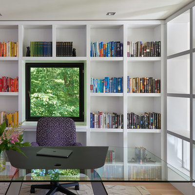 Inspiration for a large contemporary freestanding desk medium tone wood floor and brown floor study room remodel in DC Metro with white walls and no fireplace