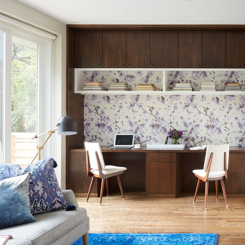 Small Midcentury Modern Home Office Idea In Chicago With A Built Desk Multicolored