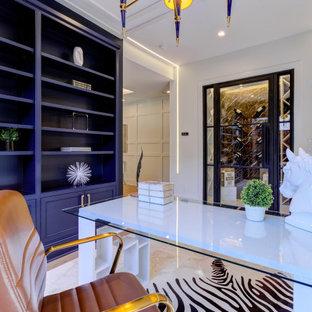 Foto de despacho madera y madera, tradicional renovado, de tamaño medio, madera, con paredes azules, suelo de mármol, escritorio independiente y madera
