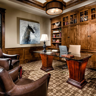 Example of a classic freestanding desk carpeted study room design in Los Angeles with beige walls