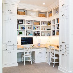 Home office - traditional built-in desk beige floor home office idea in Salt Lake City