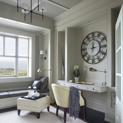 Inspiration for a timeless built-in desk dark wood floor home office remodel in Dublin with gray walls