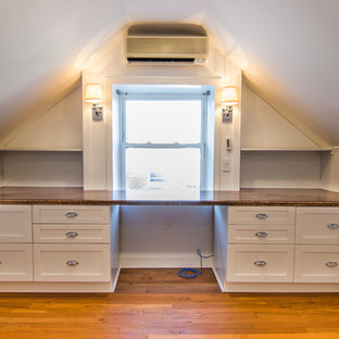 Inspiration for an arts and crafts study room in DC Metro with white walls, no fireplace and a built-in desk.