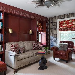デンバーのトラディショナルスタイルのおしゃれなホームオフィス・書斎 (ライブラリー、赤い壁、カーペット敷き、ベージュの床) の写真