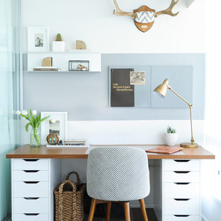 Study room - transitional freestanding desk study room idea in Vancouver with multicolored walls