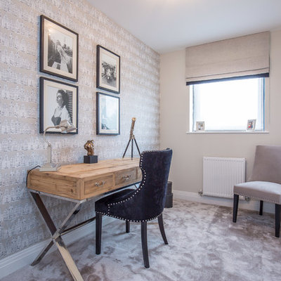Small transitional freestanding desk carpeted and gray floor study room photo in Hertfordshire with gray walls