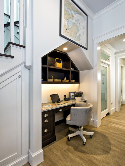 Inspiration for a small timeless built-in desk medium tone wood floor home  office remodel