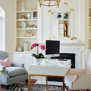 Idéer för vintage arbetsrum, med beige väggar, en standard öppen spis, ett fristående skrivbord, mellanmörkt trägolv, en spiselkrans i trä och brunt golv