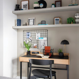 Inspiration for a small contemporary study in London with white walls, carpet, a freestanding desk and grey floors.