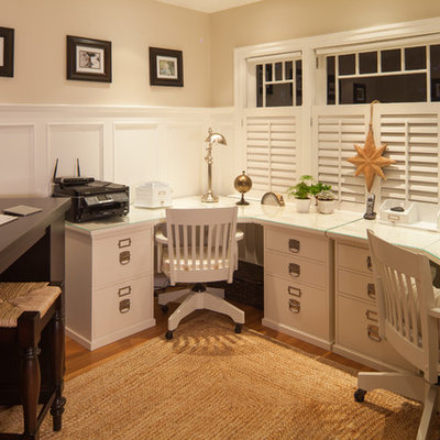 Inspiration for a timeless built-in desk medium tone wood floor home office remodel in Vancouver with beige walls