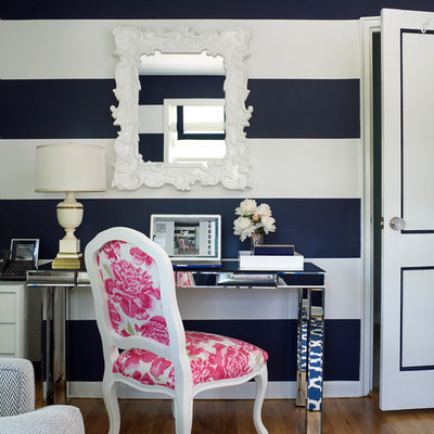 Home office - transitional freestanding desk medium tone wood floor home office idea in New York with multicolored walls