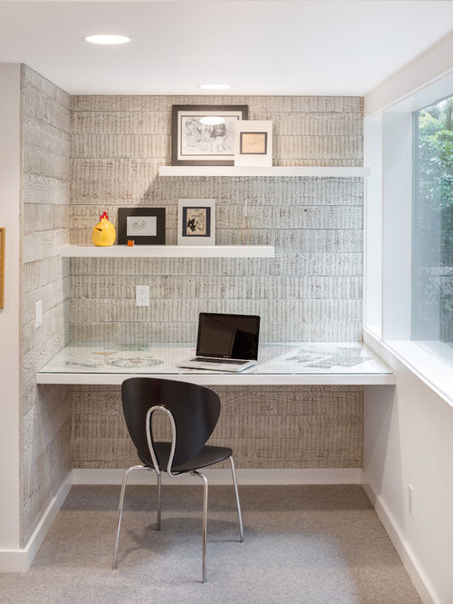 example of a midcentury modern home office design in portland