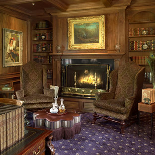 Inspiration for a medium sized traditional study in Cleveland with brown walls, carpet, a standard fireplace and a metal fireplace surround.
