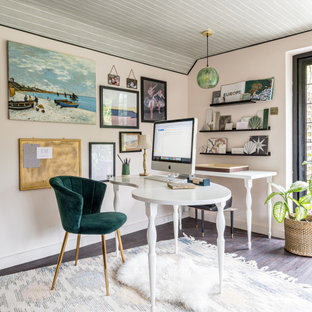 Photo of a beach style home office in Surrey.