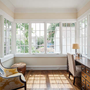 Inspiration for a timeless freestanding desk medium tone wood floor home office remodel in Houston with beige walls