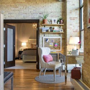 Urban freestanding desk medium tone wood floor home office photo in Minneapolis