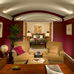 Example of a mid-sized classic freestanding desk medium tone wood floor study room design in Atlanta with red walls and no fireplace