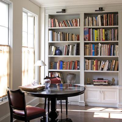 Elegant freestanding desk dark wood floor home office photo in Los Angeles