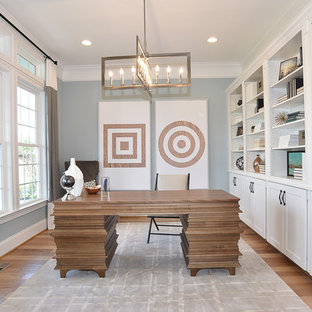 Mid-sized transitional freestanding desk medium tone wood floor study room photo in DC Metro with gray walls and no fireplace