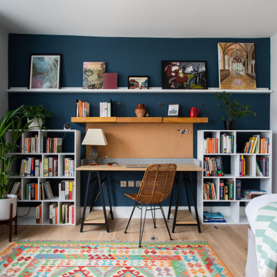 Study room - mid-sized contemporary freestanding desk light wood floor and beige floor study room idea in London with white walls
