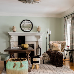 Inspiration for a large transitional freestanding desk medium tone wood floor study room remodel in Boston with green walls, a standard fireplace and a tile fireplace