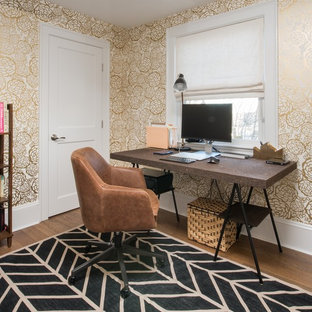 Design ideas for a mid-sized transitional study room in Boston with multi-coloured walls, a freestanding desk, medium hardwood floors, no fireplace and brown floor.