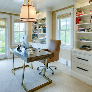 Design ideas for a nautical home office and library in Boston with beige walls, light hardwood flooring, a freestanding desk and beige floors.