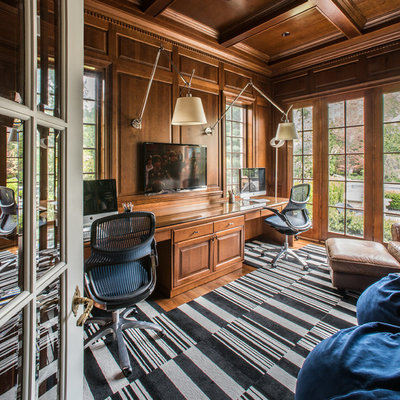 Study room - large traditional built-in desk carpeted study room idea in Chicago with brown walls and no fireplace