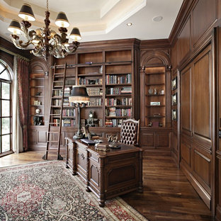 Home office library - large victorian freestanding desk home office library idea in Charlotte