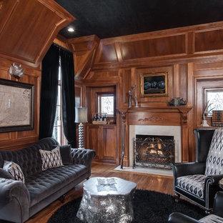 Ispirazione per un grande studio classico con pareti nere, pavimento in legno verniciato, camino classico e cornice del camino in pietra