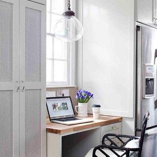 Study room - mid-sized transitional built-in desk medium tone wood floor study room idea in Atlanta with gray walls