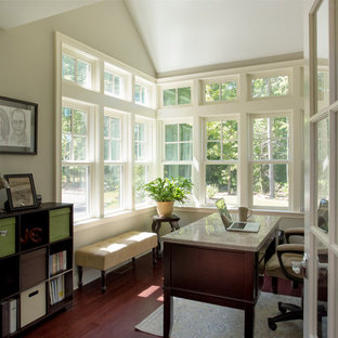 Example of a small transitional freestanding desk dark wood floor study room design in Boston with beige walls and no fireplace
