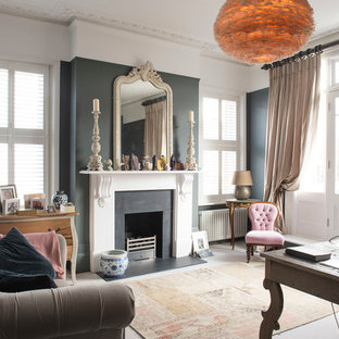Design ideas for a classic home studio in London with grey walls, a standard fireplace, a metal fireplace surround, a freestanding desk and grey floors.