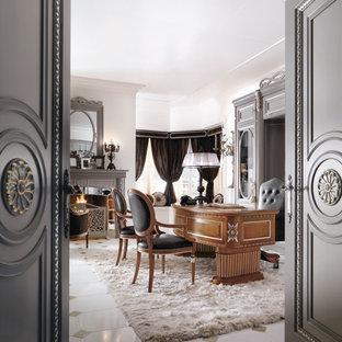 Immagine di un grande ufficio con pareti bianche, pavimento in gres porcellanato, camino classico, cornice del camino in metallo e scrivania autoportante