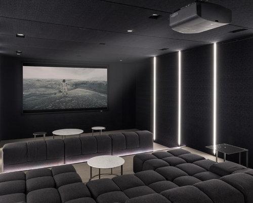 salle de cin ma avec un sol en moquette et un mur noir photos et id es d co de salles de cin ma. Black Bedroom Furniture Sets. Home Design Ideas