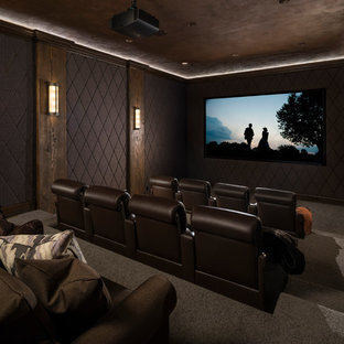 Home theater - large rustic enclosed carpeted and brown floor home theater idea in Salt Lake City with brown walls and a projector screen