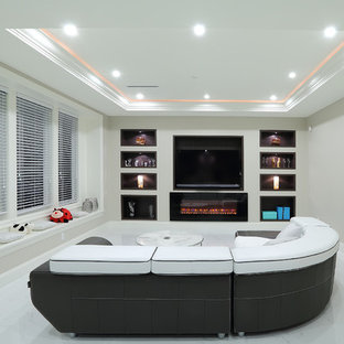 Photo of a modern home theatre in Vancouver with grey walls, ceramic floors and a built-in media wall.