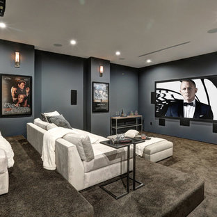 Contemporary enclosed home theatre in Los Angeles with grey walls, carpet, a projector screen and grey floor.