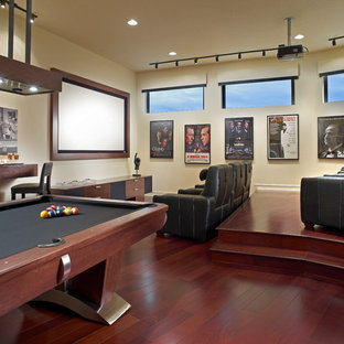 Trendy red floor home theater photo in Detroit with white walls