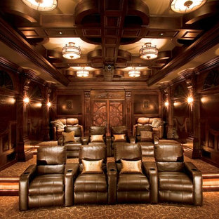 Large minimalist enclosed carpeted and multicolored floor home theater photo in Atlanta with brown walls