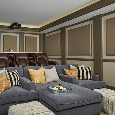Large transitional enclosed carpeted and beige floor home theater photo in Grand Rapids with beige walls and a projector screen