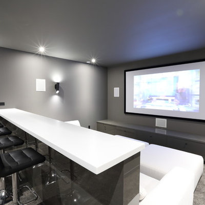 Inspiration for a mid-sized contemporary enclosed carpeted and gray floor home theater remodel in Vancouver with gray walls and a projector screen