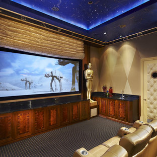 Inspiration for a large contemporary enclosed carpeted home theater remodel in Miami with beige walls and a media wall