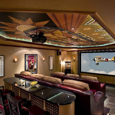 Large elegant enclosed carpeted and multicolored floor home theater photo in Other with beige walls and a projector screen