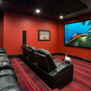 Example of a classic carpeted and multicolored floor home theater design in Minneapolis with red walls and a projector screen