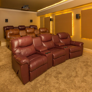 Example of a mid-sized minimalist enclosed carpeted and beige floor home theater design in Raleigh with beige walls and a projector screen
