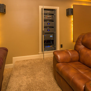 Mid-sized minimalist enclosed carpeted and beige floor home theater photo in Raleigh with beige walls and a projector screen