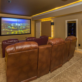 Home theater - mid-sized modern enclosed carpeted and beige floor home theater idea in Raleigh with beige walls and a projector screen