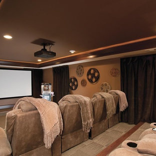 Design ideas for a traditional home theatre in Atlanta with a projector screen.